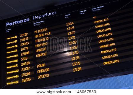 MILAN, ITALY - NOVEMBER 6, 2015: Timetable shows cancelled trains at the Milano Porta Garibaldi railway station in Milan, Lombardy, Italy, during the one-day rail strike in Northern Italy.