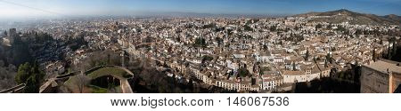 GRANADA, SPAIN - JANUARY 12, 2016: Panorama of El Albayzin district in Granada, Andalusia, Spain, pictured from the Torre de la Vela in the Alacazaba Fortress.