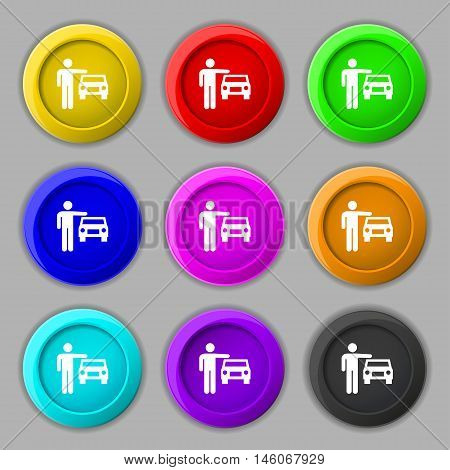 Person Up Hailing A Taxi Icon Sign. Symbol On Nine Round Colourful Buttons. Vector