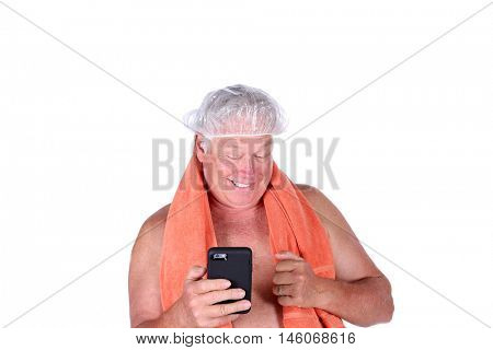 A man takes a Selfie photo of himself with his cell phone. isolated on white. room for text. model released