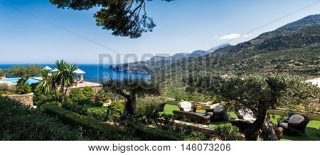 Mediterranean resort by the sea, with old olive groves and the sitting area