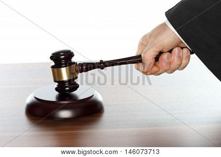 lawyer is working with symbolic gavel on desk