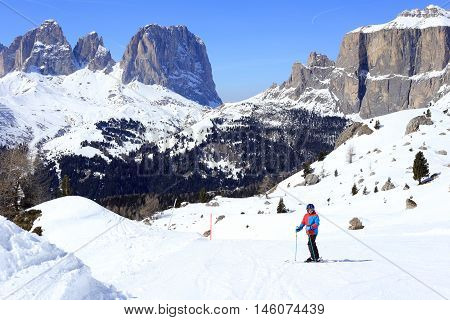 young boy on a ski run in italy