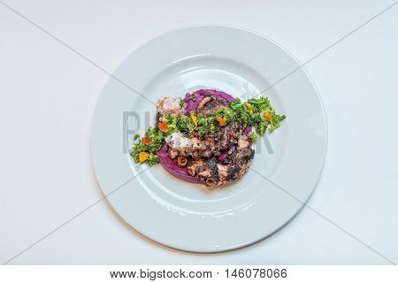 grilled octopus with mushed beet roth and green salad