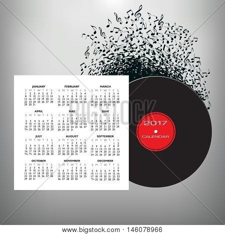 Musical notes buzz around a record album in this 2017 calendar
