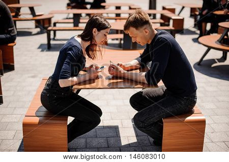 Secretive Couple with Smart Phones in Their Hands Young adult couple has privacy problems with modern technology