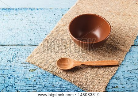 Ceramic Bowl And Wooden Spoon On The Table