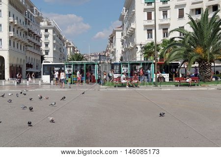 Thessaloniki, Greece - September 04 2016: Aristotelous square public bus stop. People waiting on the bus stop at Mitropoleos street on the central square of Thessaloniki.
