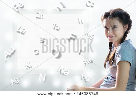 formulas. cute girl on the background of table of Mendeleev