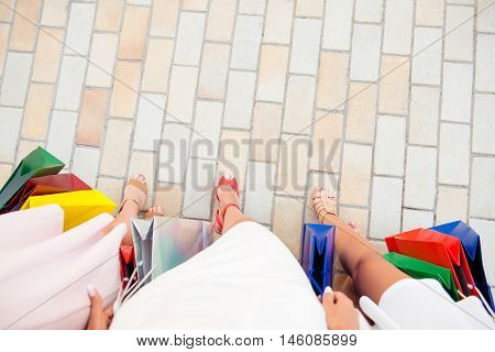 Top View Of Women Walking After Shopping On Paving Stone