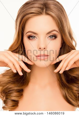 Close Up Portrait Of Sensual Woman Touching Her Face