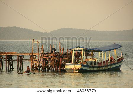 Wooden jetty and fishing boat Koh Rong Samlon island Cambodia Southeast Asia