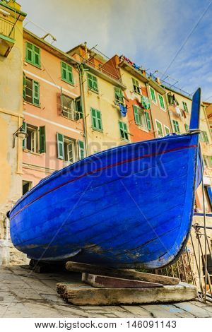 Old blue boat in Riomaggiore one of the five villages of the Cinque Terre on Italy mediterranean coast.