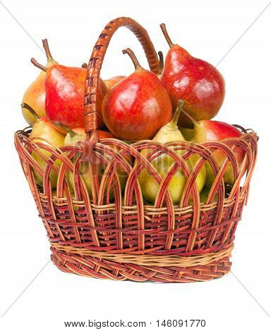 pears in a wicker basket isolated on white background.