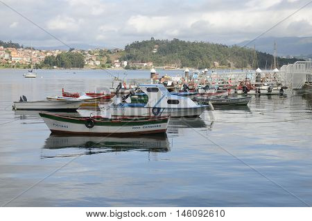 COMBARRO, SPAIN - AUGUST 4, 2016: Fishing boats parked in the ria in Combarro a village of the province of Pontevedra in the Galicia region of Spain.