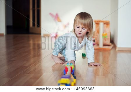 Little Girl Playing With Train