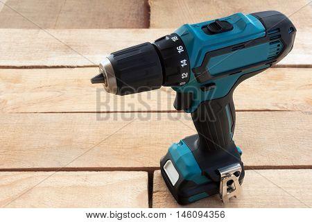 blue screwdriver on a light wooden background