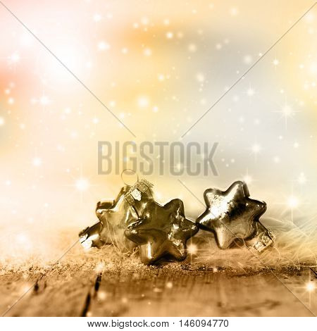 Wintry background with Silver and golden Christmas stars