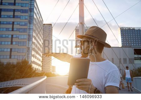 Tourist Pointing At A Building During  Video Call