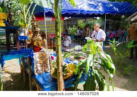 CHIANG RAI THAILAND - SEPTEMBER 1 : unidentified man in traditional white cloth ritualising in front of altar table on September 1 2016 in Chiang rai Thailand.