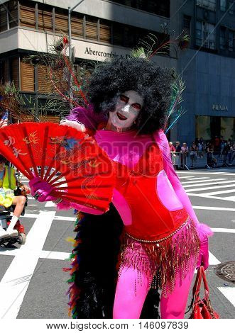 New York City - June 30 2007: Man in drag with red fan and clown face at the 2007 Gay Pride Parade on Fifth Avenue