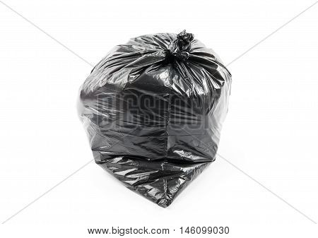 Black garbage bag isolated on white background