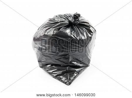 Black garbage bag isolated on white background