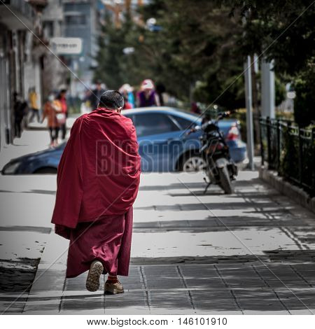 SHANGRI-LA, CHINA - April 20, 2016:Lama are walking in the city.