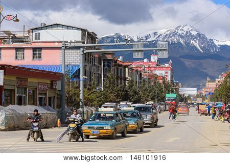 SHANGRI-LA, CHINA - April 20, 2016:Traffic intersection in the Shangri-la city with the snow mountains background.