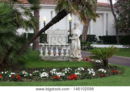 Cannes, France - July 1 2012. Statue and lights meet visitors at the entrance in the evening.