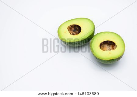 Two half avocado isolated on a white background.