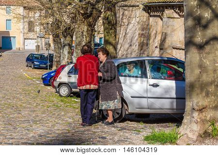 Carcassonne, France - April 1, 2011: Group Of Aged French Women Talking Near Cathedral