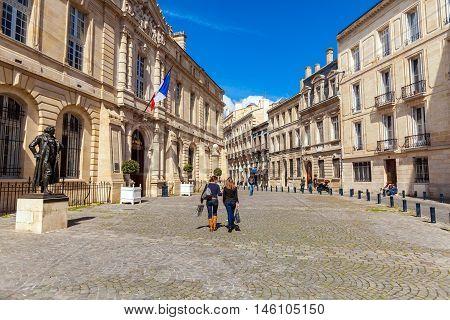 Bordeaux, France - April 4, 2011: Two French Girls Walking In Front Of Francisco De Goya Statue