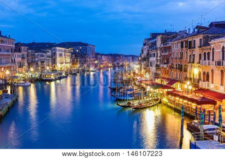 Beautiful and romantic view over traditional architecture among the Grand canal, in Rialto area, Venice city, Italy