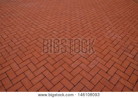 Sidewalk, paved with red tiles. Beautiful background