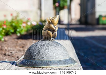 LITHUANIA KLAIPEDA - JULY 20 2016: Sculpture of nice little mouse in oldtown Klaipeda. Lithuania.