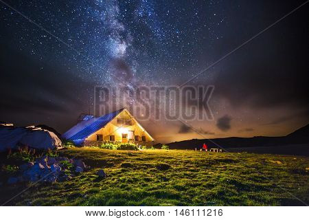 Hut In The Mountains At Night Under The Milkyway