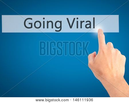 Going Viral - Hand Pressing A Button On Blurred Background Concept On Visual Screen.