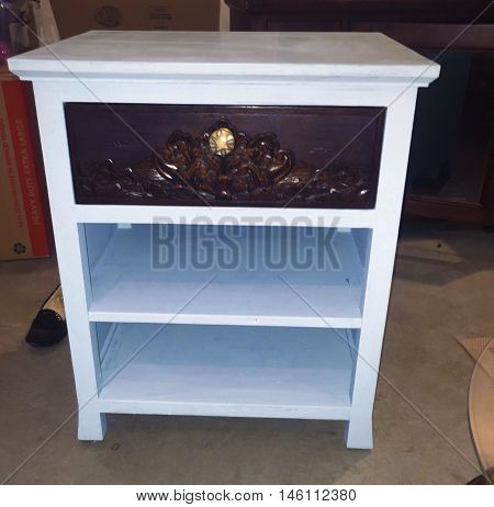 side table painted with chalk pain in baby blue and brown