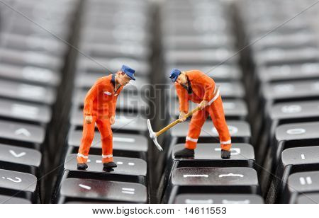 Workers Repairing Keyboard