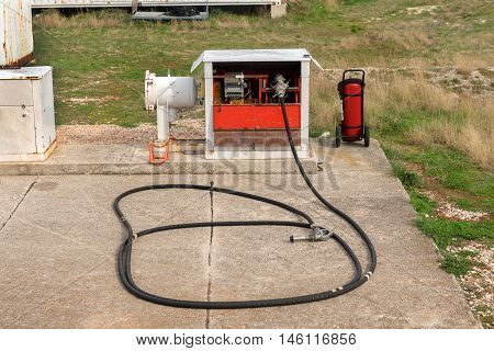 Gasoline nozzle and hose at the airport