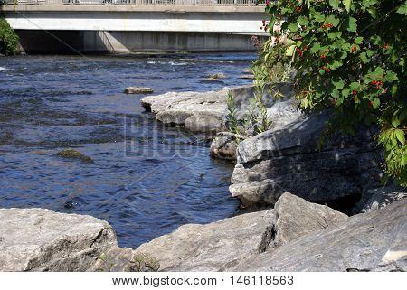 A closeup underneath the bridges streaming riverway.