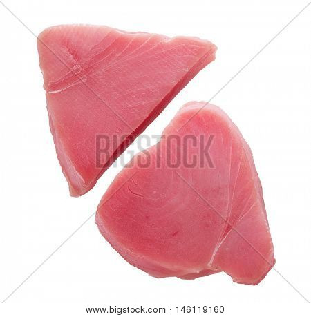 Raw yellowfin tuna steaks isolated on a white background