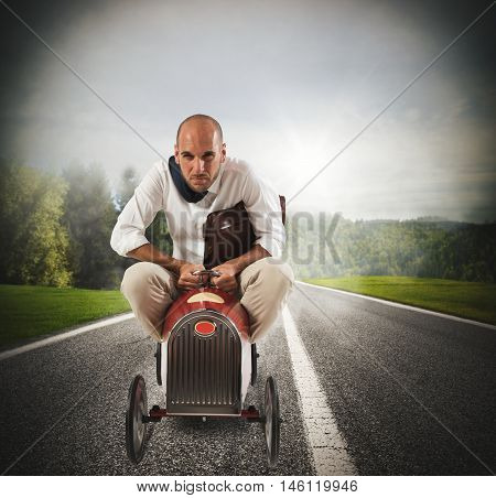 Businessman with bag driving quickly a small car