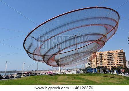 PORTO, PORTUGAL - AUG 22: She Changes sculpture by Janet Echelman at a roundabout in Porto, Portugal, as seen on Aug 22, 2016. The net is made of 36 individual mesh sections in different densities.