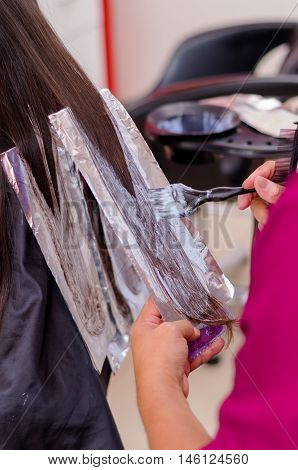Alumminium helps to fix the hair color, long brown hair ready to be dye.