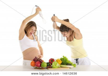 Two women are preparing to attack the fruit
