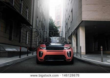 Moscow, Russia - August 06, 2016: Car Land Rover Range Rover Evoque standing on asphalt road in city Moscow at sunset