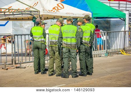 BARRANQUILLA, COLOMBIA - FEBRUARY 15, 2015: Police supervise the safety in Colombia's most important folklore celebration, the Carnival of Barranquilla, Colombia