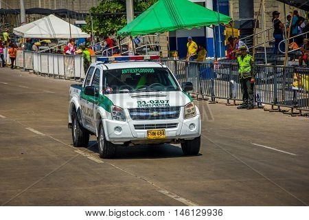 BARRANQUILLA, COLOMBIA - FEBRUARY 15, 2015: Police cars patrolling streets just before Colombia's most important folklore celebration, the Carnival of Barranquilla, Colombia